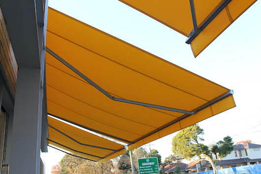 Siena folding arm awning