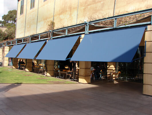 drop-arm-commercial_Traditional-Automatic-Awnings