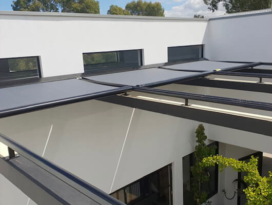 Retractable roofing system skyline tension